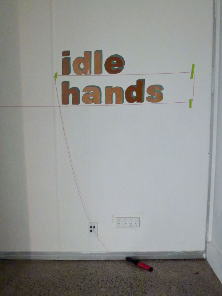idle hands wood grain vinyl,  paint pen, plumb line and tape