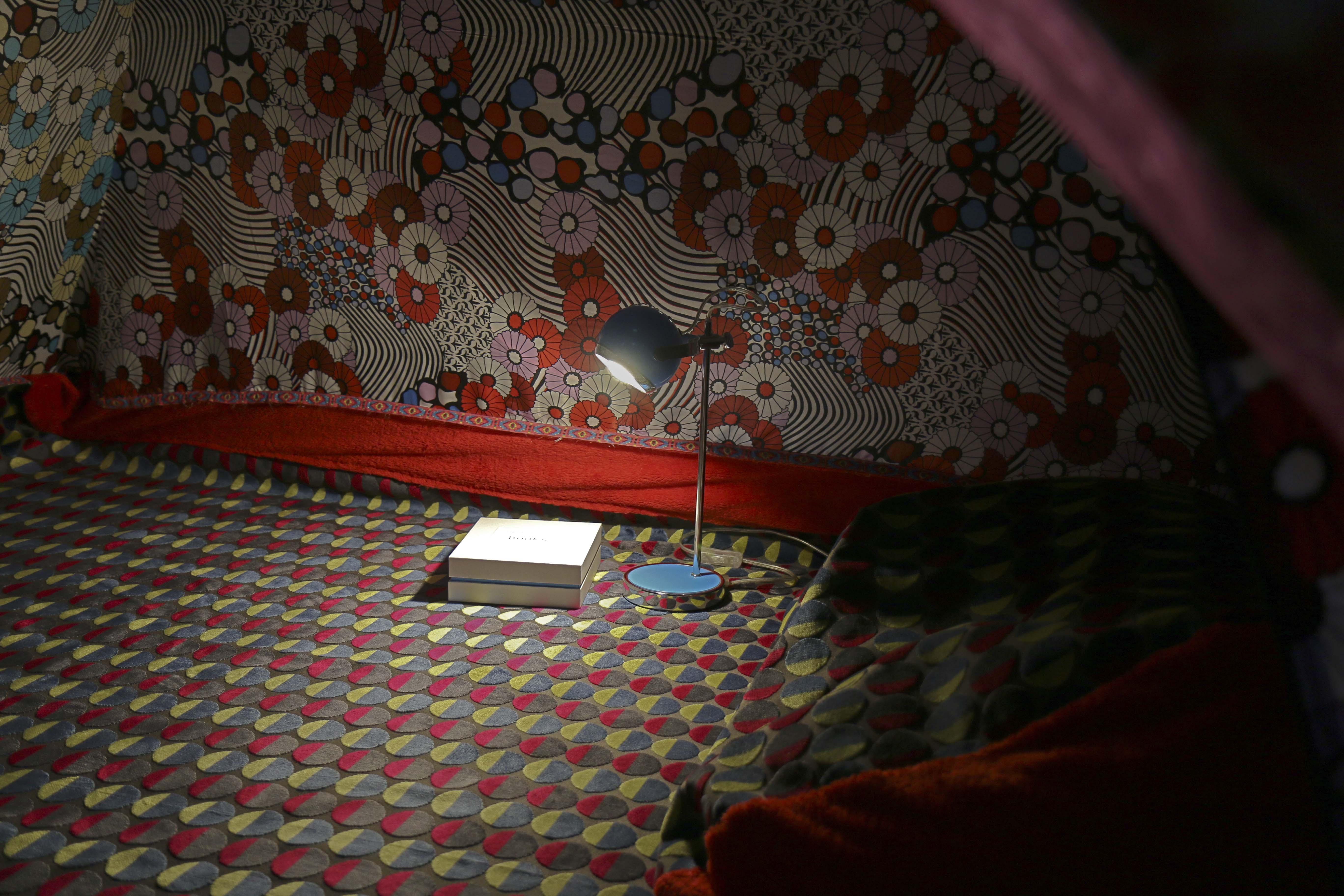 tent interior, book box and lamp